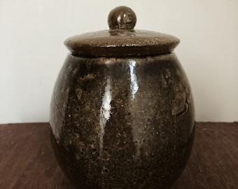 Small ceramic covered jar