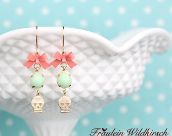 """Mint-skullies"" sweet skulls with bows"
