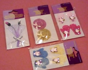 Four Packs of Embellishments for Papercrafting