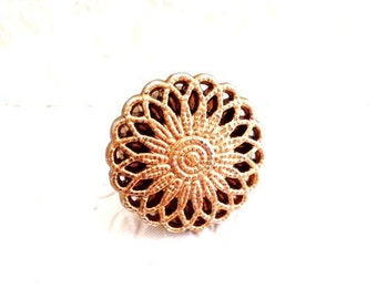 Filigree ring looks classic in matte gold.