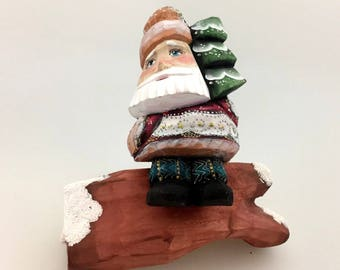Santa Claus on timber, Christmas tree, decoration handmade and hand-painted figure, ornament for Christmas holidays and home decoration