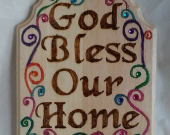 God Bless Our Home wood burned plaque with decorated with curls and swirls on pine, half marquee sign, embellished with colored crystals.