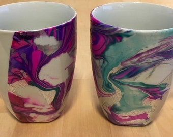 White mug pair with purple, fuchsia, green and silver marbling/dip dyed