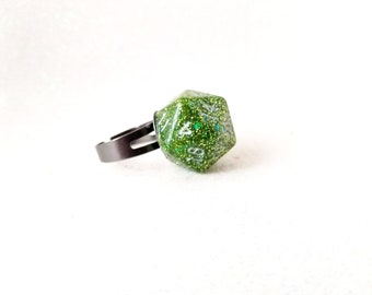 Individually cast clear resin D20 dice ring with moss green glitter