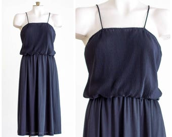 1970s black blouson dress with pleated chiffon bodice and full skirt
