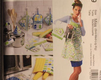 McCalls 6479   Kitchen Towel, Potholders, Bags and Apron in Size   Small, Medium, Large and XLarge