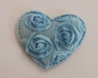 very pretty blue heart with flowers in relief
