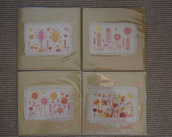 Four garden design fabric cards