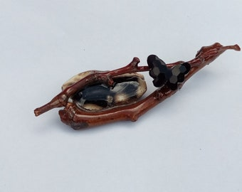Agate in a natural branch brooch