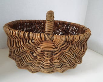 small wicker twig buttock butt basket with woven handle rustic
