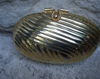 Opulent Gilt Metal Oval Shaped Grooved Evening Bag c 1980s