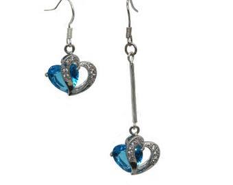 """""""Heart earrings with silver on asymmetrical Crystal twisted heart"""""""