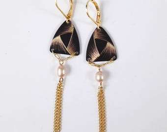 Triangular earrings etched brass with a decorative pattern reminiscent of a Ribbon.