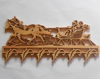 Horse drawn sled wall hanging