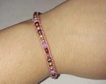 Pink cord beaded wrap bracelet with flower clasp