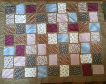 Quilt TOP in woven browns, steal blues, reds and creams.  This quilt top is pieced together and read for quilting