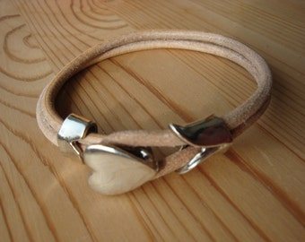 Leather bracelet with silver tone heart