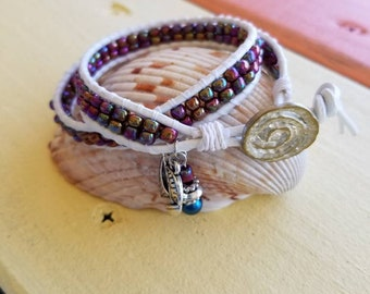 Double Wrap Bracelet made with Round White Leather Cord with Iridescent Beads and Button Closure and Boat Charm