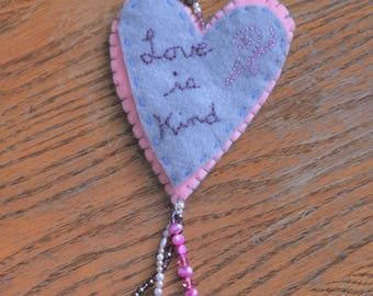 Embroidered gray and pink felt heart ornament, Love is Kind