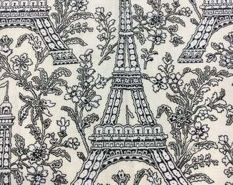 Michael Miller Fabrics Eiffel Tower. Black print on cream backgtound. Sold by the half yard.