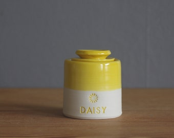 pet urn. lidded customized urn with name and stamp. urn for pet ashes or human cremains. yellow glaze on porcelain clay with paw stamp