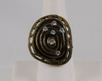 Dinner Ring Antiqued brass Misshapened circle Filigree edge Maze design in center Black enamel 6 Rhinestones Adjustable Pristine