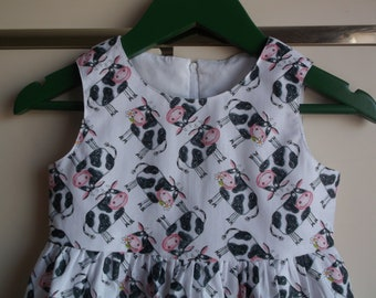 Cows with daisies dress