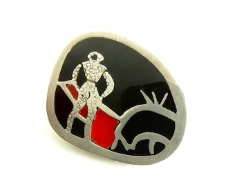 Circa 1950.  Mexican Matador Brooch with Onyx and Carnelian inlay