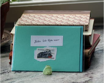 Better late than never Pale mint green card with handwritten quote and Swedish train locomotive postal stamp