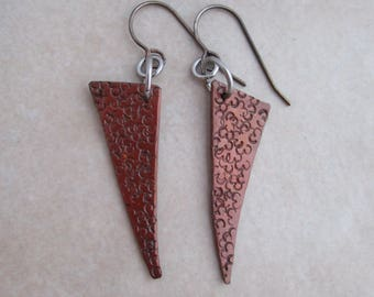 I got this earrings patterned copper sterling silver dangle
