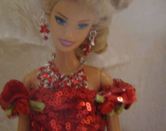 Barbie in red sequined  night at the opera, includes dress and pre-owned doll with shoes and jewerly