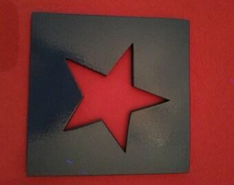 Below flat form star, wood