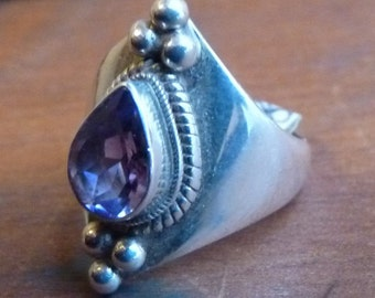Sterling with faceted amethyst teardrop