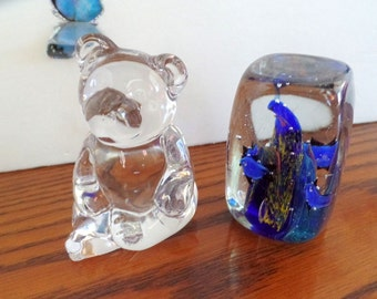 Pair vintage paperweights.  Crystal Teddy Bear, & Blue multi color weight with fish.