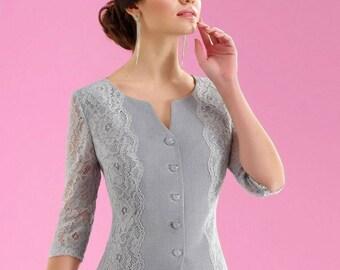 Women's skirt suit. Suit skirt.  Jacket, skirt. Elegant designer suit in the spirit of modern Parisian classics