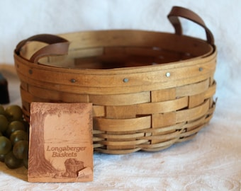 """1985 Longaberger 10"""" Round Button Basket with Leather Handles signed by Judy and Carmen Longaberger"""