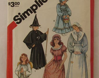 Vintage 1982 Simplicity pattern #5741 includes 22 pieces to create 5 misses' and girls' costumes plus accessories, sizes 10/12