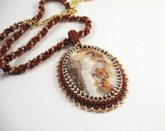 Embroidered Crazy Lace Agate Pendant on Woven Bead Necklace