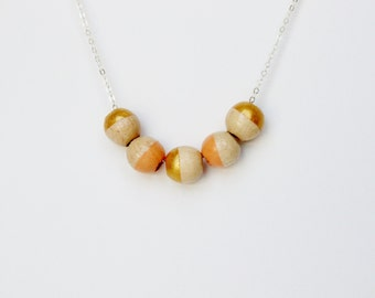 Gold and Peach Wooden Geometric Bead Necklace on a Sterling Chain