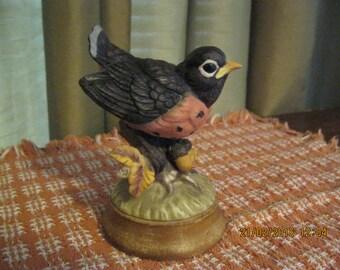 Vintage ceramic flegling robin bird figurine used