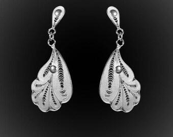 Poseidon earrings in silver embroidery