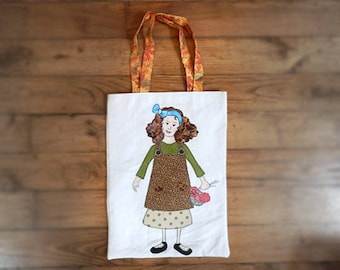 Unique Handmade Cotton Tote Bag, with applique design of a lady holding flowers. Decorative and handy!