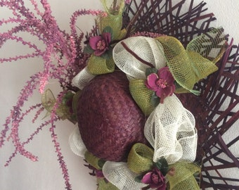 Spring hat for wall