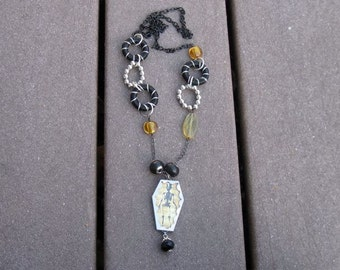 Mr. Bones black, silver, yellow necklace
