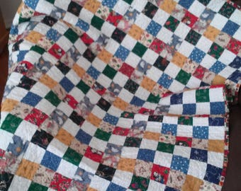 A cute patchwork of fabric quilt /A crib quilt/ Child Quilt