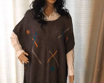Women's poncho detailed with felting designs to create a unique and OOAK garment piece