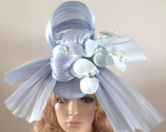 pale blue perching beret hat adorned with a silk abaca sculpture & a spray of silken japanese orchids