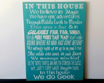 In This House We Do Geek Sign. This Sign is Great For Fans of Harry Potter, Hunger Games, Star Wars, and Lord of The Rings. Great gift Idea!
