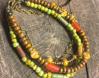Bohemian 4 strand multicolored bracelet with antiqued brass box clasp