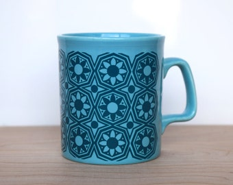 Vintage Staffordshire potteries turquoise mug with retro floral pattern